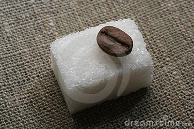 Coffee beans on the sugar