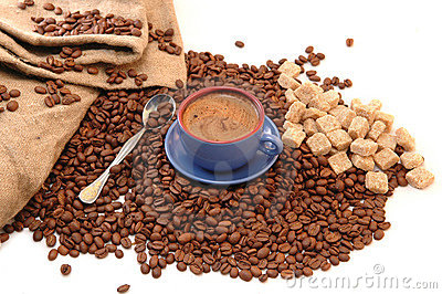 Coffee beans, sugar and cup