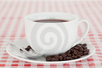 Coffee and beans on a tablecloth