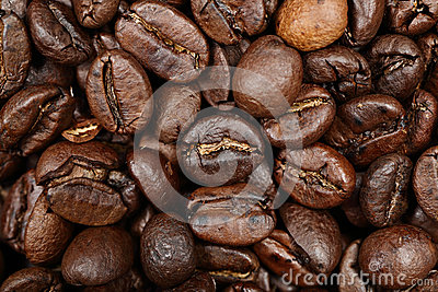 Coffee beans texture background closeup