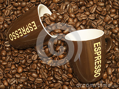 Coffee beans with two espresso cups