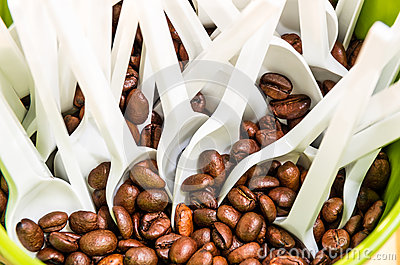 Coffee Beans with white plastic Spoons