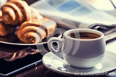 Coffee break business. Cup of coffee mobile phone and newspaper. Stock Photo