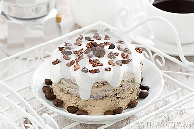 Coffee Cake With Icing Decorated With Cocoa Beans On A ...