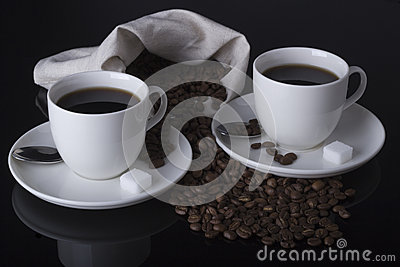 Coffee and coffee beans in table