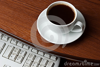 Coffee on computer desk