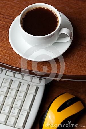 Coffee on computer desk