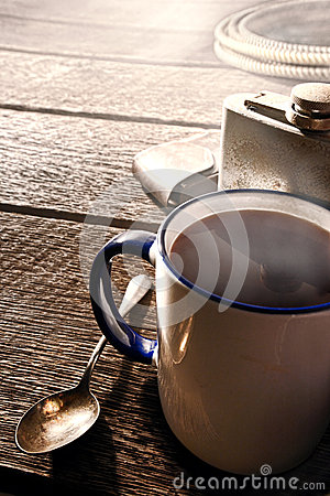 Free Coffee Cup And Flask With Cowboy Gear In A Ranch Royalty Free Stock Photography - 38331697