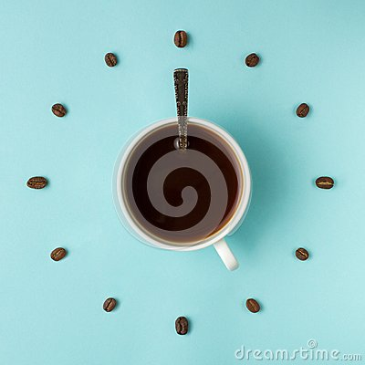 Free Coffee Cup And Roasted Beans Arranged As Clock Face On Blue Background, Top View. Coffee Time Symbol. Interesting Idea Energy And Stock Image - 114357871