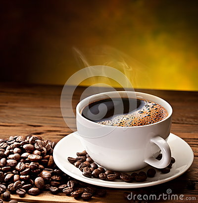 Free Coffee Cup And Saucer On A Wooden Table. Royalty Free Stock Images - 26448329
