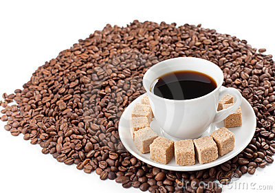 Coffee cup on beans pile isolated