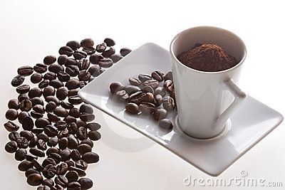 Coffee cup and beans on table