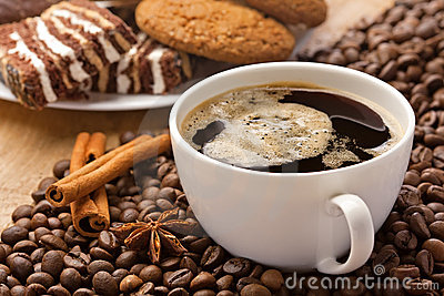 Coffee cup, cinnamon, anise and sweets
