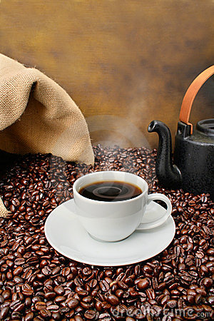 Free Coffee Cup Close-up Over Roasted Beans Royalty Free Stock Photos - 4871148