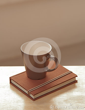 Coffee cup with diary