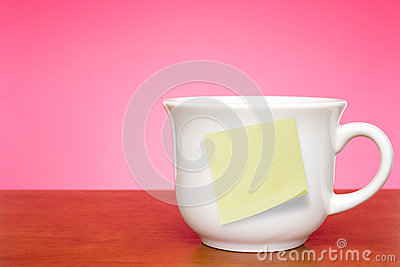 Coffee cup with empty sticky note