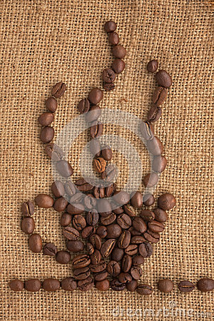 Coffee cup made of coffee beans on a burlap