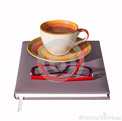 Coffee cup on notebook