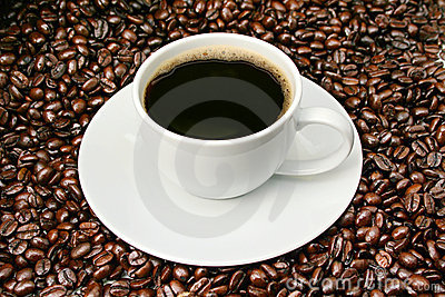 Coffee cup over roasted beans