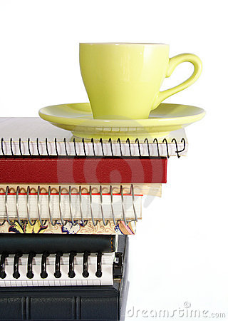 Coffee Cup on Pile of Notebook