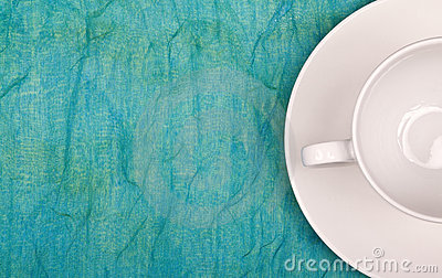 Coffee cup and soucer standing on table