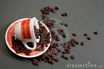 Coffee cup spilling beans