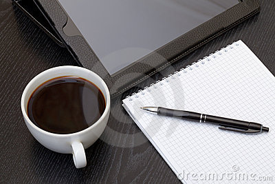 Coffee cup, spiral notebook and pen