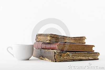 Coffee cup and three old book