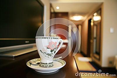 Coffee cup beside TV
