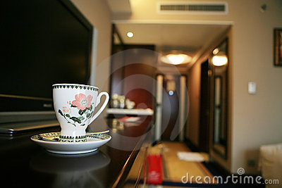Coffee cup beside TV