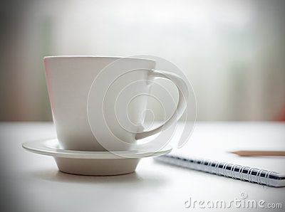 Coffee cup on white table