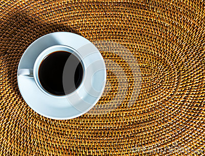 Coffee cup on a wicker placemat
