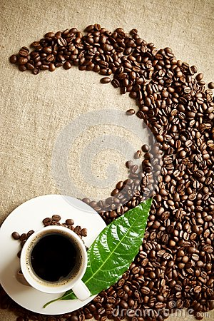 Free Coffee Cup With Beans Twisted In A Swirl On Flax Textile Stock Image - 56483211