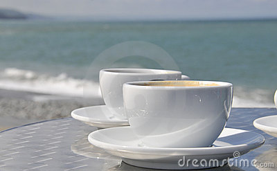 Coffee cups and beach