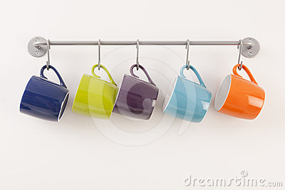 Colorful cups on metal rack