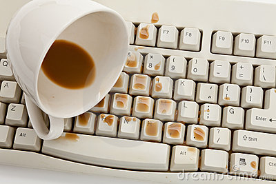 Coffee and damaged computer keyboard