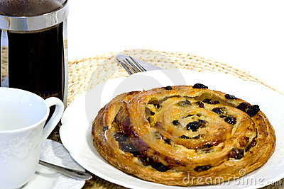 Coffee and Danish pastry on white ground