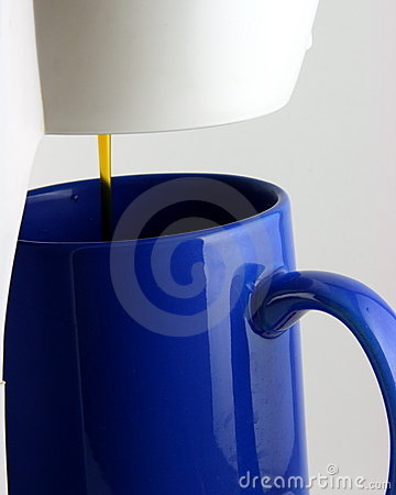 Coffee drip and blue mug