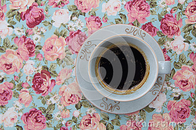 Coffee on the flower tablecloth