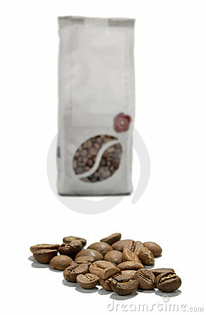 Coffee grains and a package of coffee in grains