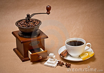 Coffee-grinder and cup of hot coffee
