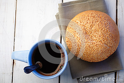 Coffee and loaf with sesame