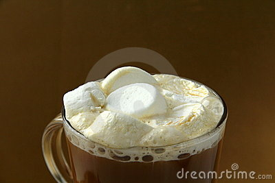 Coffee with marshmallows in large glass beaker