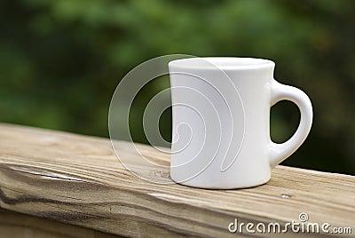 Coffee Mug on Railing