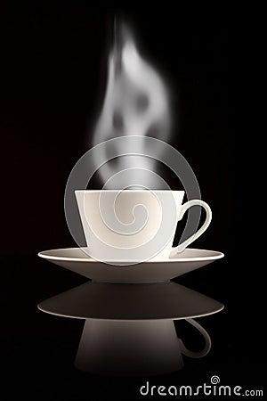 Coffee mug with smoke on black reflective surface