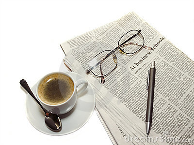 Coffee, the newspaper, pencil