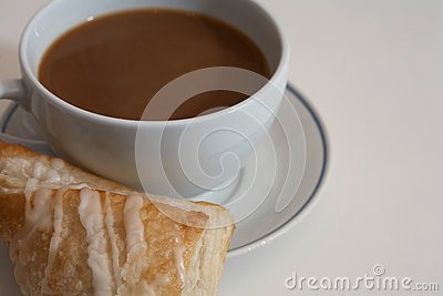 Coffee and pastry on white
