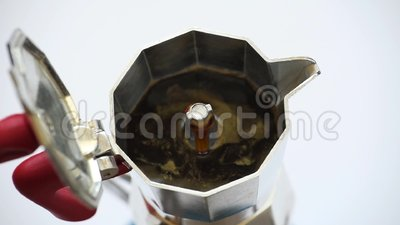 Coffee maker with coffee. Coffee pot while coffee comes, top view, white background, Italian coffee, taste and aroma stock video footage