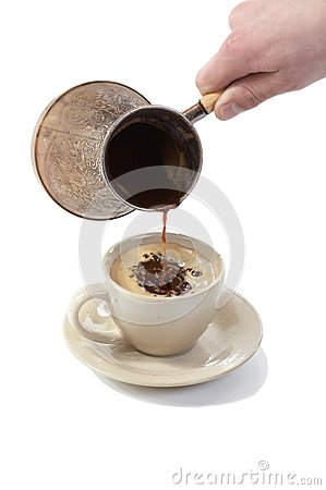 Coffee poured from coffee maker in cup