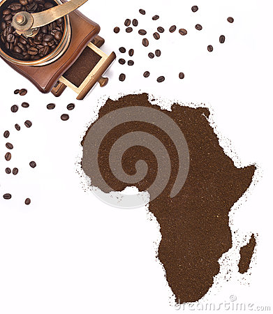Free Coffee Powder In The Shape Of Africa And A Coffee Mill.(series) Royalty Free Stock Photography - 49084307
